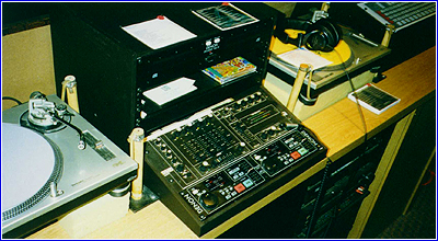 diamonds dj booth, denon cd player and rane mixer